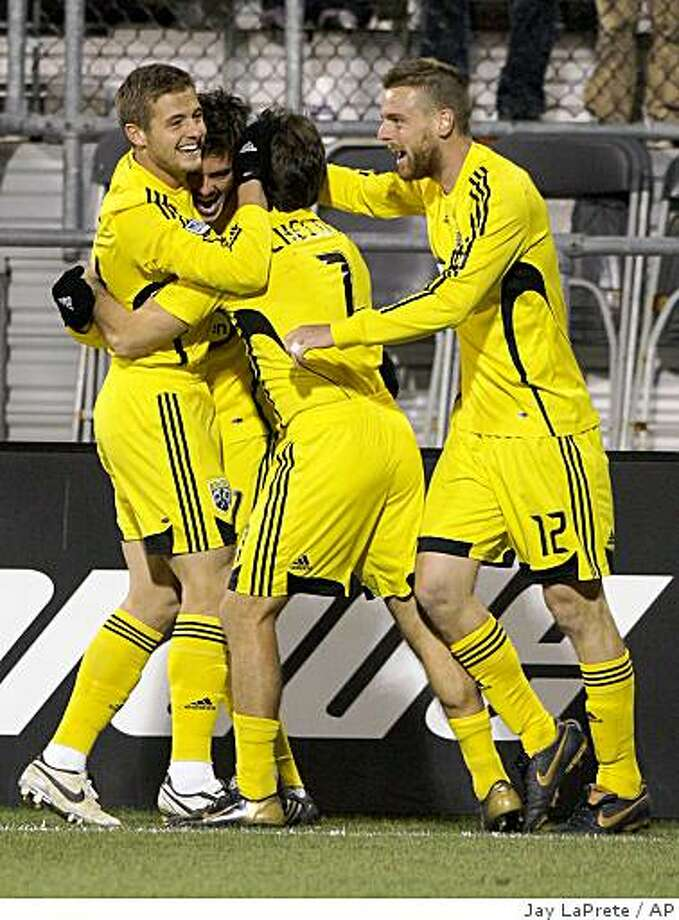 From left to right, Columbus Crew's Robbie Rogers, Brad Evans, Guillermo Barros Schelotto and Eddie Gaven celebrate Evans' goal against the Kansas City Wizards during the first half Saturday, Nov. 8, 2008, in Columbus, Ohio. The Crew defeated the Wizards 2-0. Photo: Jay LaPrete, AP
