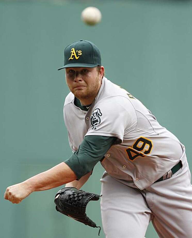 Oakland Athletics' Brett Anderson delivers a pitch against the Boston Red Sox during the first inning of a baseball game at Boston's Fenway Park, Thursday, June 3, 2010. Photo: Steven Senne, AP
