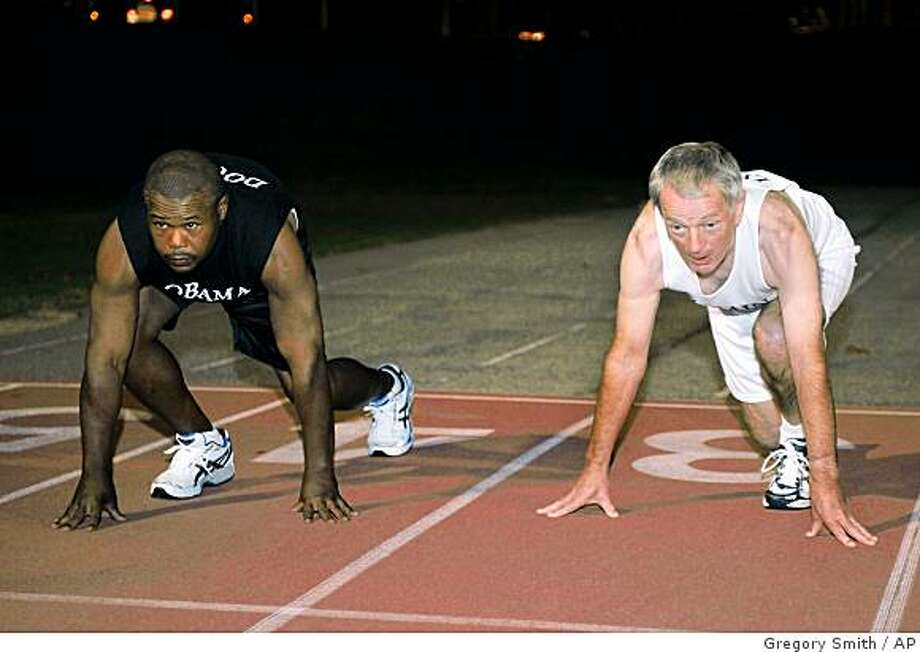 **APN ADVANCE FOR SUNDAY NOV. 9** Antonio Douglas, left, readys to race his boss, Cactus Car Wash owner Frank Lynch, right, during an charity 100 meter dash at Grady High School Stadium Sunday, Oct. 26,  2008 in Atlanta. (AP Photo/Gregory Smith) Photo: Gregory Smith, AP