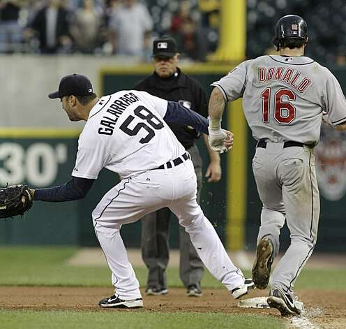 Detroit Tigers pitcher Armando Galarraga (58) covers first base as Cleveland Indians' Jason Donald, right, runs to the base and umpire Jim Joyce looks on in the ninth inning of a baseball game in Detroit Wednesday, June 2, 2010. Joyce called Donald safe and Galarraga lost his bid for a perfect game with two outs in the ninth inning on the disputed call at first base. Detroit won 3-0. Photo: Paul Sancya, AP