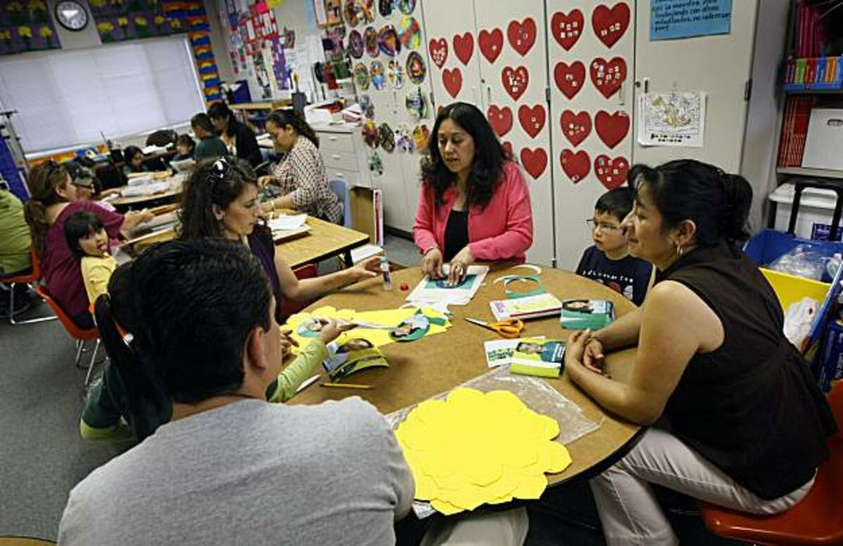 Ma Elena Villagas (center in pink) a teacher at Adelante Academy in San Jose gets help from her volunteer Parents Wednesday May 19, 2010and or Guardians of schoolchildren attending public schools in the Alum Rock Unified School District in San Jose will soon be required to volunteer 30 hours of parent involvement much like private schools, but the practice is unusual in public schools system.