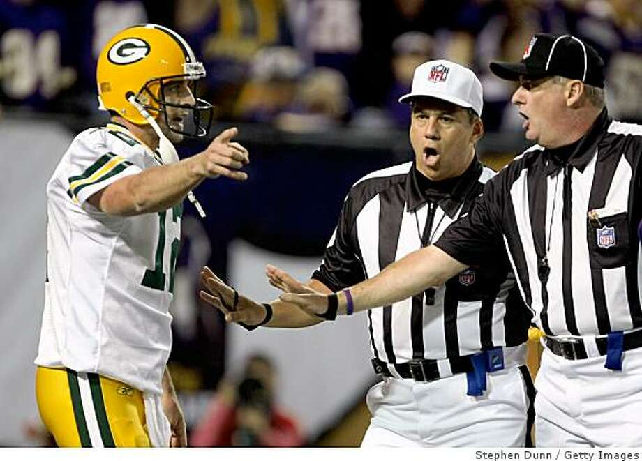 MINNEAPOLIS - NOVEMBER 09:  Quarterback Aaron Rodgers #12 of the Green Bay Packers argues with the officials after drawing an illegal forward pass in the penalty in the end zone for a safety against the Minnesota Vikings on November 9, 2008 at the Metrodome in Mineapolis, Minnesota.  The Vikings won 28-27.  (Photo by Stephen Dunn/Getty Images) Photo: Stephen Dunn, Getty Images