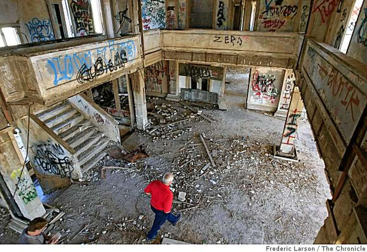 Owner David Fowler walks through the main lobby of once was the elite Byron Hot Springs Hotel in Byron Calif., on Friday November 7, 2008, that is now been trashed by vandal and covered in graffiti over the years.