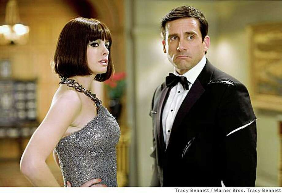 """Steve Carell and Anne Hathaway in """"Get Smart"""" 2008ANNE HATHAWAY stars as Agent 99 and STEVE CARELL stars as Maxwell Smart in Warner Bros. Pictures� and Village Roadshow Pictures� action comedy �Get Smart,� distributed by Warner Bros. Pictures.PHOTOGRAPHS TO BE USED SOLELY FOR ADVERTISING, PROMOTION, PUBLICITY OR REVIEWS OF THIS SPECIFIC MOTION PICTURE AND TO REMAIN THE PROPERTY OF THE STUDIO. NOT FOR SALE OR REDISTRIBUTION Photo: Warner Bros. Tracy Bennett, Tracy Bennett"""