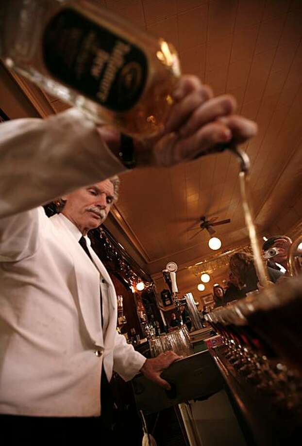 Bartender Larry Nolan says the number of Irish coffees he's poured in his 35 years is in the millions. He sets up ten more as the Buena Vista Cafe kicks off a three-day celebration in honor of the 56th anniversary of the introduction of the Irish coffee on Saturday, Nov. 8, 2008 in San Francisco, Calif. Photo: Kim Komenich, The Chronicle