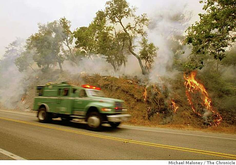 A US Forest Service fire truck  drives past a back fire east of Highway 1 near Big Sur, Calif. on July 6, 2008. Nearly 2,000 firefighters try to beat back the out-of-control Basin Complex wildfire near the coastal tourist town of Big Sur.Photo by Michael Maloney / The Chronicle Photo: Michael Maloney, The Chronicle