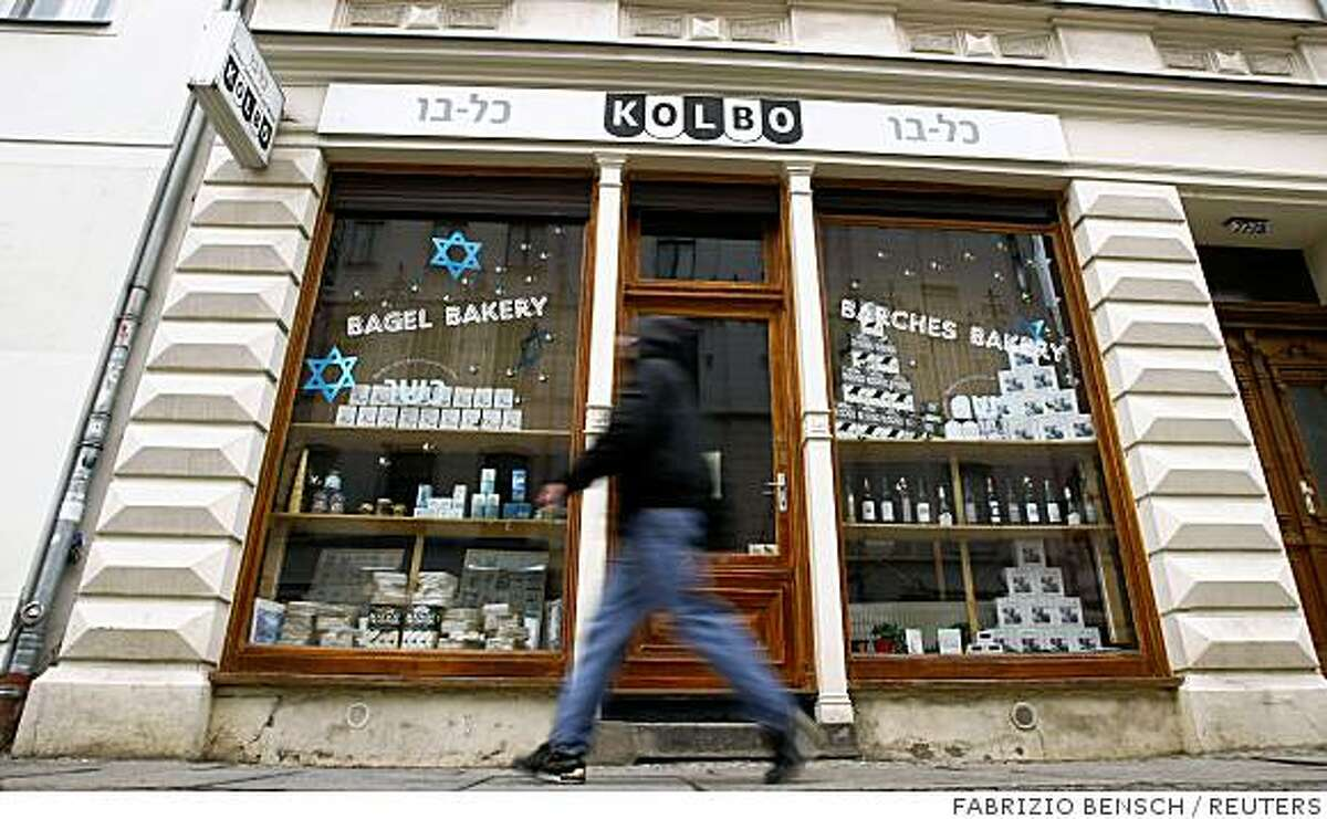 A pedestrian walks past a shop for kosher food at Berlin's Mitte district November 3, 2008. Germany marks November 9, 2008 the 70th anniversary of the 1938