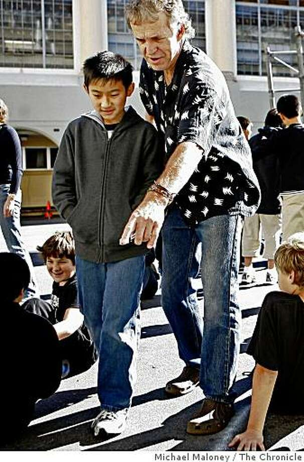 Conceptual artist Daniel Dancer helps direct two hundred kids at Presidio Middle School in San Francisco, Calif., to form a big butterfly in the school courtyard as part of a school project on November 11, 2008. Photo: Michael Maloney, The Chronicle