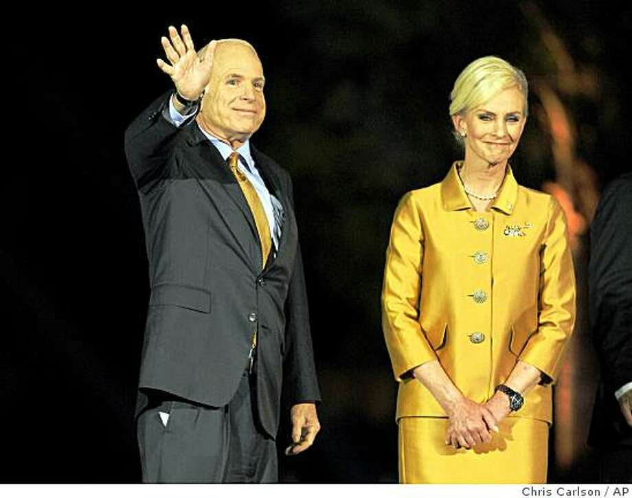 Sen. John McCain, R-Ariz., left, is joined by wife Cindy as he finishes his concession speech to a rally of supporters on election night in Phoenix, Tuesday, Nov. 4, 2008.  (AP Photo/Chris Carlson) Photo: Chris Carlson, AP