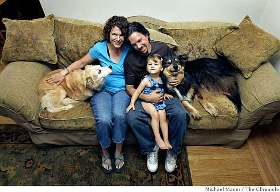 On The Couch with, Christine Beirne and John Forte with daughter Ellen, 2 and dogs Gracie and Maggie at their Redwood City, Calif. home on Sept. 6, 2008. Photo: Michael Macor, The Chronicle