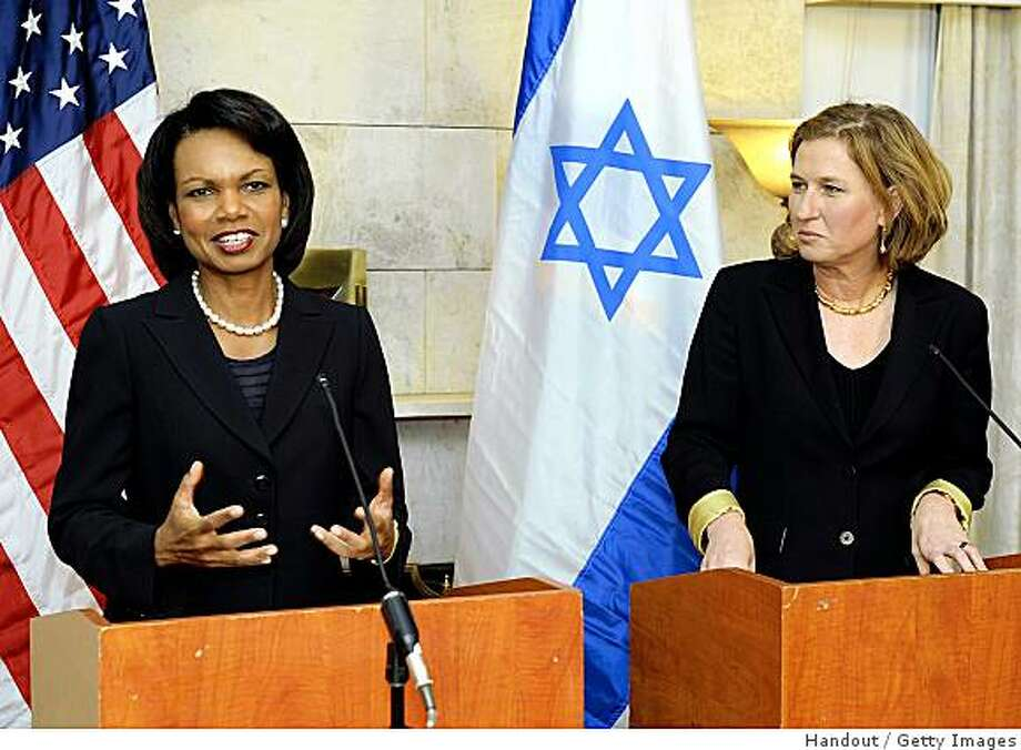 HERZLIYA, ISRAEL - NOVEMBER 6:  In this handout from U.S. embassy Tel Aviv, Foreign Affairs Minister of Israel Tzipi Livni (R) and U.S. Secretary of State Condoleezza Rice hold a press conference at the U.S. ambassador to Israel's residence on November 6, 2008 in Herzliya, Israel. Early today Rice met with Israeli Prime Minister Ehud Olmert and is in Israel to urge a peace deal between the Israelis and the Palestinians.  (Photo by Matty Stern/U.S. embassy Tel Aviv via Getty Images) Photo: Handout, Getty Images