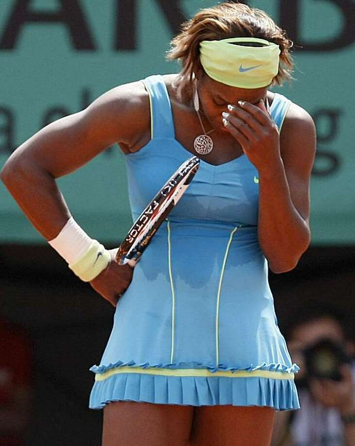 USA's Serena Williams reacts after being defeated by Australia's Samantha Stosur during a quarter final match for the French Open tennis tournament at the Roland Garros stadium in Paris, Wednesday, June 2, 2010. Photo: Michel Spingler, AP