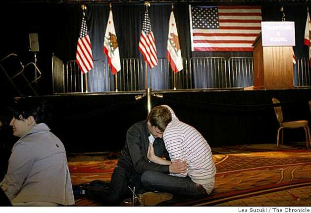 Niklas Olsson and Joey Vaughan (l) of Palo Alto embrace on the floor of the Grand Ballroom at the Westin St. Francis. Photo: Lea Suzuki, The Chronicle