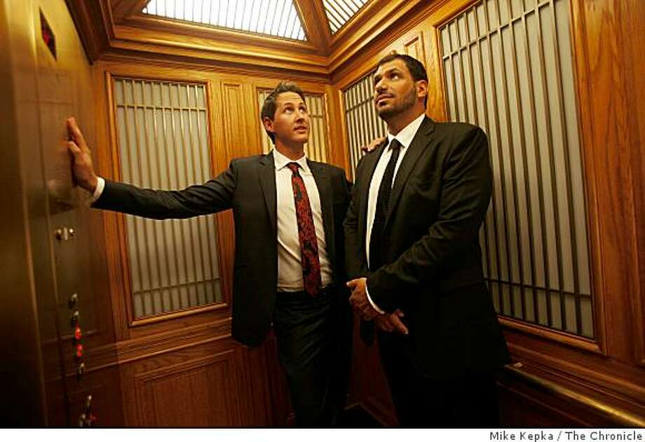 Trevor Godwin, 28, (left) and Paul Rubenstein, 41, of San Francisco, head down the elevator after their wedding at San Francisco City Hall on Tuesday Nov. 4, 2008 in San Francisco, Calif. Photo: Mike Kepka, The Chronicle