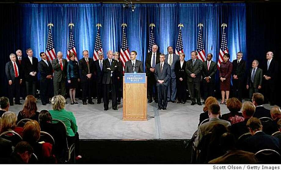 CHICAGO - NOVEMBER 07:  President-elect Barack Obama holds his first post-election press conference at the Hilton Hotel flanked by his vice president-elect Joe Biden (L), his new chief of staff Rahm Emanuel (R), and members of his Transition Economic Advisory Board November 7, 2008 in Chicago, Illinois. The Press conference followed a meeting with his Transition Economic Advisory Board.  (Photo by Scott Olson/Getty Images) Photo: Scott Olson, Getty Images