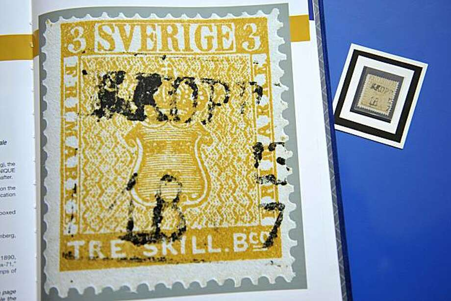 "A David Feldman employee shows what is believed to be the world's most expensive stamp, the Swedish ""Treskilling Yellow - Error of Color"",  at David Feldman Philatelists auctioneers in Geneva, Switzerland, Thursday, May 20, 2010. Treskilling Yellow is estimated to be worth 1.5 - 2.0 million euro (US dlrs 1.85 -  2.45 million)  . It will be sold on May 22, 2010 in Geneva. The first stamp of Sweden issued in 1855 was printed in green, but 30 years later one example was found in yellow. The stamp was discovered by a Swedish schoolboy on a letter of his grandmother in 1885 and sold to a stamps dealer for 7 crowns. Photo: Martial Trezzini, AP"