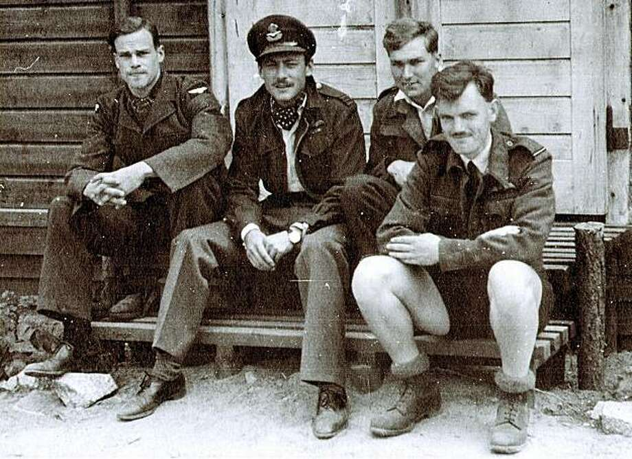 "FILE --Jack Harrison, at right, the veteran thought to be the last survivor of the World War II prisoner-of-war breakout from Stalag Luft III, is seen with other prisoners-of-war in this undated file photo. Harrison, an RAF pilot, has died at the age of 97 at his home in Scotland, according to an announcement by his family. As a camp gardener, Harrison helped dispose of the dirt excavated from three escape tunnels. He was 98th on the list of some 200 inmates designated to make the escape on March 24, 1944, but only 76 got away before guards detected the breakout and raised the alarm. The breakout was celebrated in the 1963 film ""The Great Escape."" Photo: Erskine, AP"