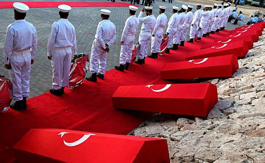 Hamas Navy officers are seen during a ceremony to honor the Turkish people that were killed aboard one of the aid ships, at the Gaza City port, Sunday June 6, 2010. The push for an international inquiry puts Israel under further pressure to explain how its attempt to stop the aid ship flotilla from breaching a tight blockade of Hamas-ruled Gaza turned deadly, with 9 activists killed, including 8 Turks and a U.S. citizen of Turkish origin. Photo: Ashraf Amra, AP