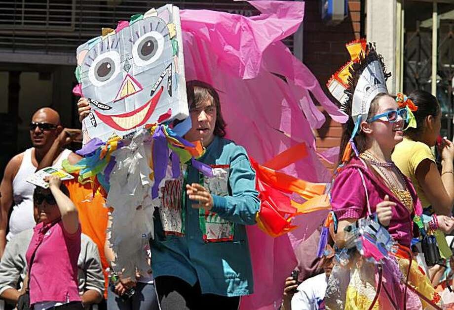 A group called Trash Mashup created masks from recycled goods, adding a green element to the annual Carnaval parade and celebration in San Francisco's Mission District. Photo: Brant Ward, The Chronicle