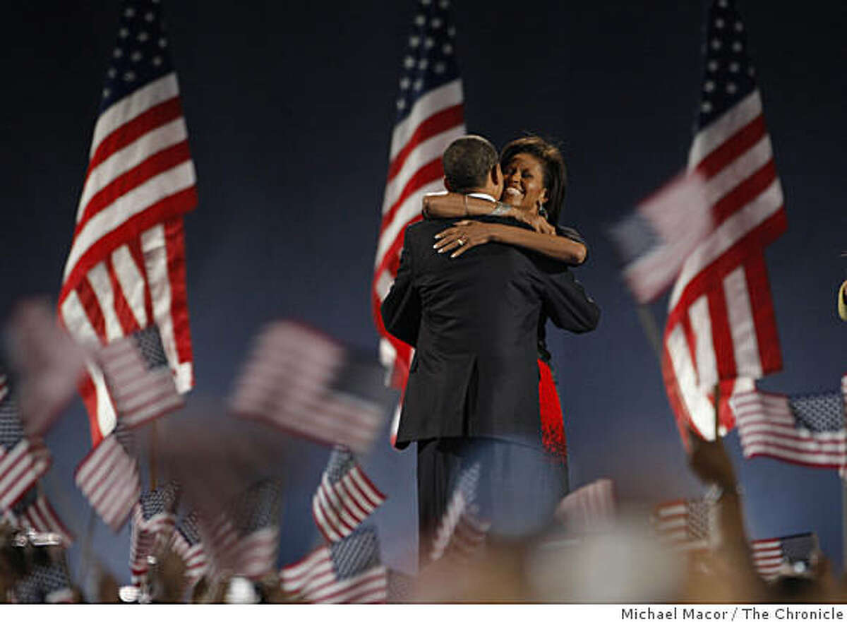 President-elect Sen. Barack Obama gets a hug from his wife Michelle during his election night rally at Grant Park in downtown Chicago, Ill. on Tuesday Nov. 4, 2008.