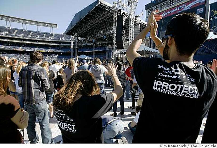 """Two people wearing shirts reading """"Make Your Vote Count on November 4, 2008, IPtotectmarriage.com"""" are among the participants in """"The Call"""" a fast and prayer gathering attended by thousands at Qualcomm Stadium in San Diego, Calif., on Saturday, Nov. 1, 2008. While not a political event, """"The Call""""  co-founder Lou Engle exhorted the audience to """"pray for California"""" several times during early hours of the 12 hour nonstop service. Audience members were asked not to bring political signs. Photo: Kim Komenich, The Chronicle"""