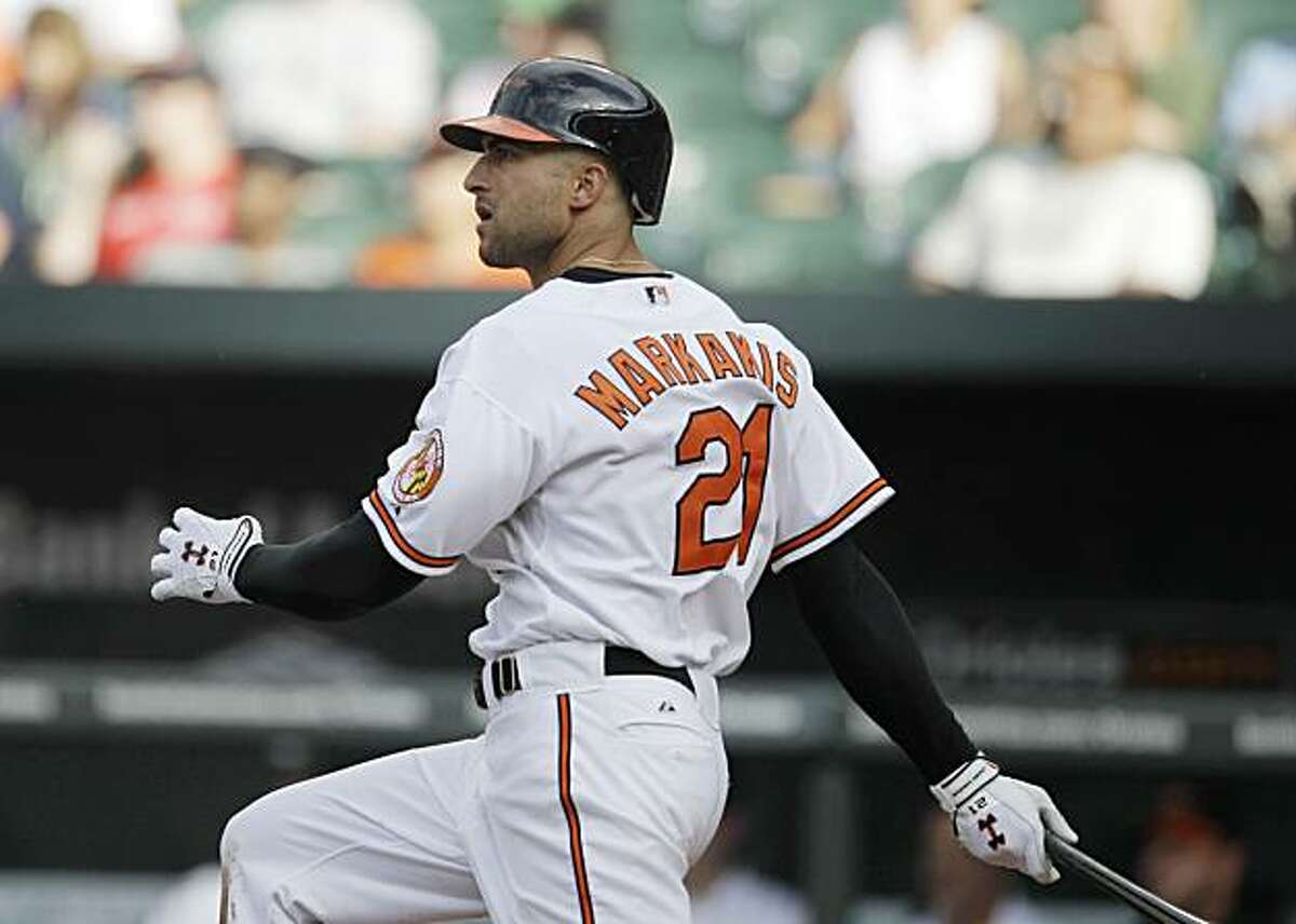 Baltimore Orioles' Nick Markakis follows his game winning RBI single against the Boston Red Sox during the 11th inning of a baseball game, Sunday, June 6, 2010, in Baltimore. The Orioles won 4-3.