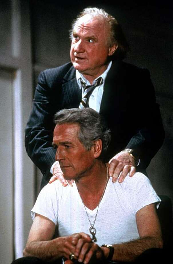 """** FILE **In this 1982 file photo, actor Paul Newman, playing a boozy Irish Catholic attorney, consults with his law associate played by Jack Warden in this scene from the film ''The Verdict.'' Newman, the Academy-Award winning superstar who personified cool as an activist, race car driver, popcorn impresario and the anti-hero of such films as """"Hud,"""" """"Cool Hand Luke"""" and """"The Color of Money,"""" has died, a spokeswoman said Saturday. He was 83. Newman died Friday, Sept. 26, 2008, of cancer, spokeswoman Marni Tomljanovic said. (AP Photo/20th Century Fox, File) ** NO SALES ** Photo: 20th Century Fox, File, AP"""