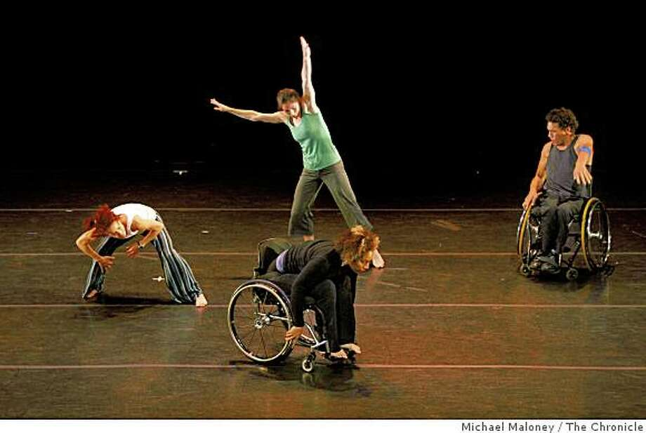 "Dancers Alice Sheppard, foreground, and Rodney Bell, right, using manual wheelchairs, and  Sonsheree Giles, left and Janet Das, center, top, rehearse ""Vessel"" which will have its world premiere during Axis Dance Company's 20th anniversary home season. Photo: Michael Maloney, The Chronicle"