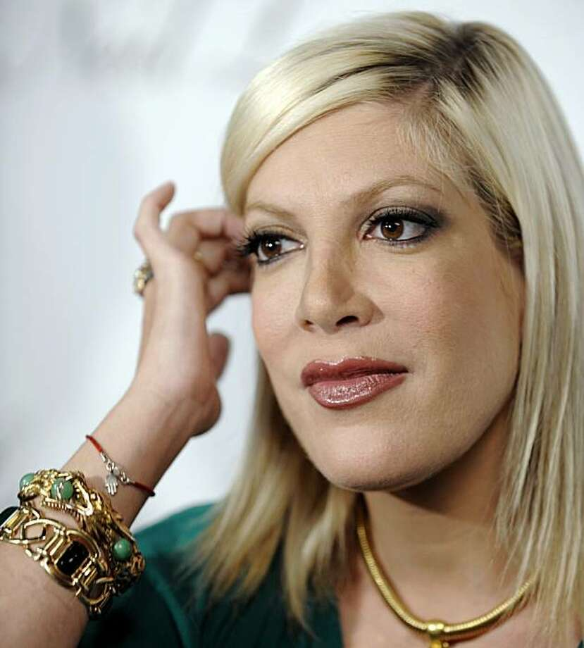 Tori Spelling  just bought a Tuscan-style villa in the suburban Encino area with six bedrooms and seven bathrooms in 6,718 square feet.   Actress Tori Spelling arrives at the private opening of Neil Lane Jewelry's flagship store in Los Angeles, Wednesday, Oct. 29, 2008. (AP Photo/Chris Pizzello) Photo: Chris Pizzello, AP