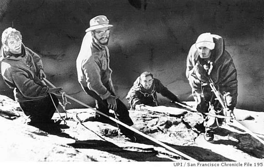 Warren Harding, far left, George Whitmore,  27, far right, and Wayne Merry, 27, who is just coming over the edge, complete their ascent of El Capitan in Yosemite National Park in 1958. Photo: UPI, San Francisco Chronicle File 195