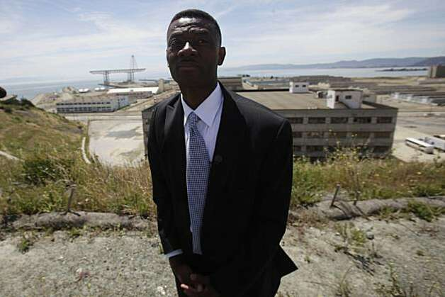 Kofi Bonner Regional Vice President Bay Area Division Lennar Urban, stands on top of the Hilltop community  with the site of the NFL stadium and other parts of the Hunters Point Shipyard redevelopment project behind him in San Francisco, Calif. on Wednesday June 2, 2010. Photo: Lea Suzuki, The Chronicle