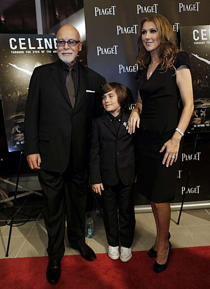 """FILE - In this photo taken Tuesday, Feb. 16, 2010, Celine Dion, right, poses with her husband Rene Angelil, left, and son Rene Charles Angelil, right, as they arrive for the premiere of the film """"Celine: Through the Eyes of the World"""" in Miami Beach, Fla. Photo: Lynne Sladky, AP"""