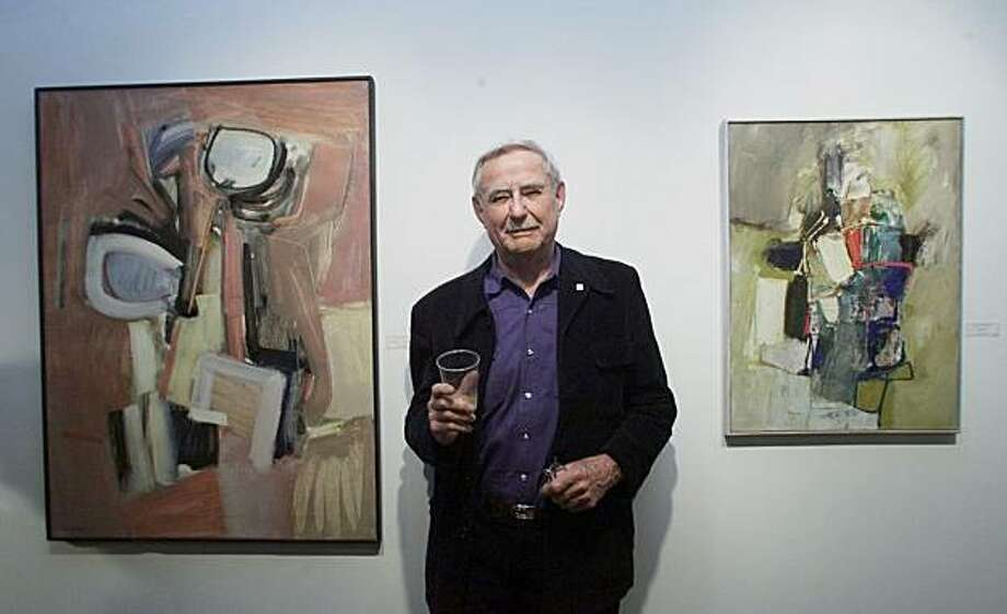 Karl Kasten with two pieces of his art on display at Robert Green Fine Art Gallery in MillValley. Photo: John O'Hara, 2001, The Chronicle