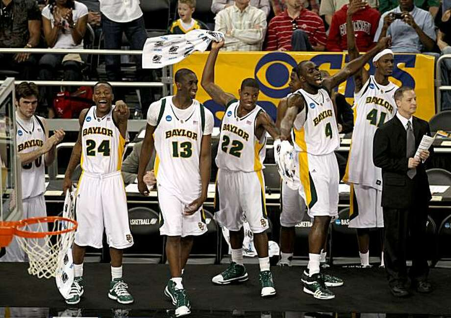 Baylor players, from left, LaceDarius Dunn (24), Ekpe Udoh (13), A.J. Walton (22), Quincy Acy (4) and Antony Jones (41) celebrate near the end of the second half against St. Mary's during NCAA South Regional basketball action onFriday, March 26, 2010, in Houston. Baylor beat St. Mary's 72-49. ( Smiley N. Pool / Chronicle ) Photo: Smiley N. Pool, Chronicle