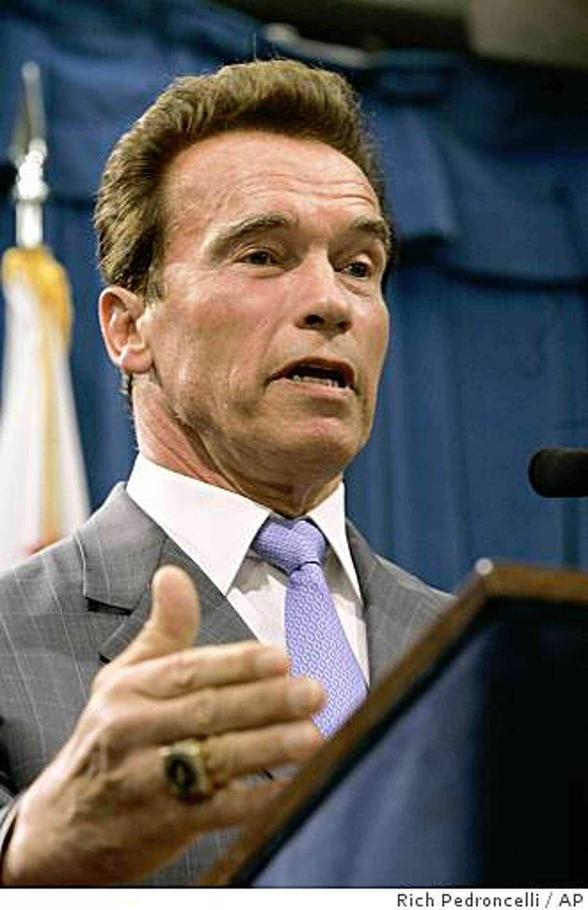Gov. Arnold Schwarzenegger discusses his proposed 1.5 percent sales tax increase during a Capitol news conference in Sacramento, Calif., Thursday, Nov. 6, 2008. Schwarzenegger proposed the tax increase, along with cuts to the current state budget, to help deal with California's fiscal crisis, which has created an $11.2 billion deficit.(AP Photo/Rich Pedroncelli)