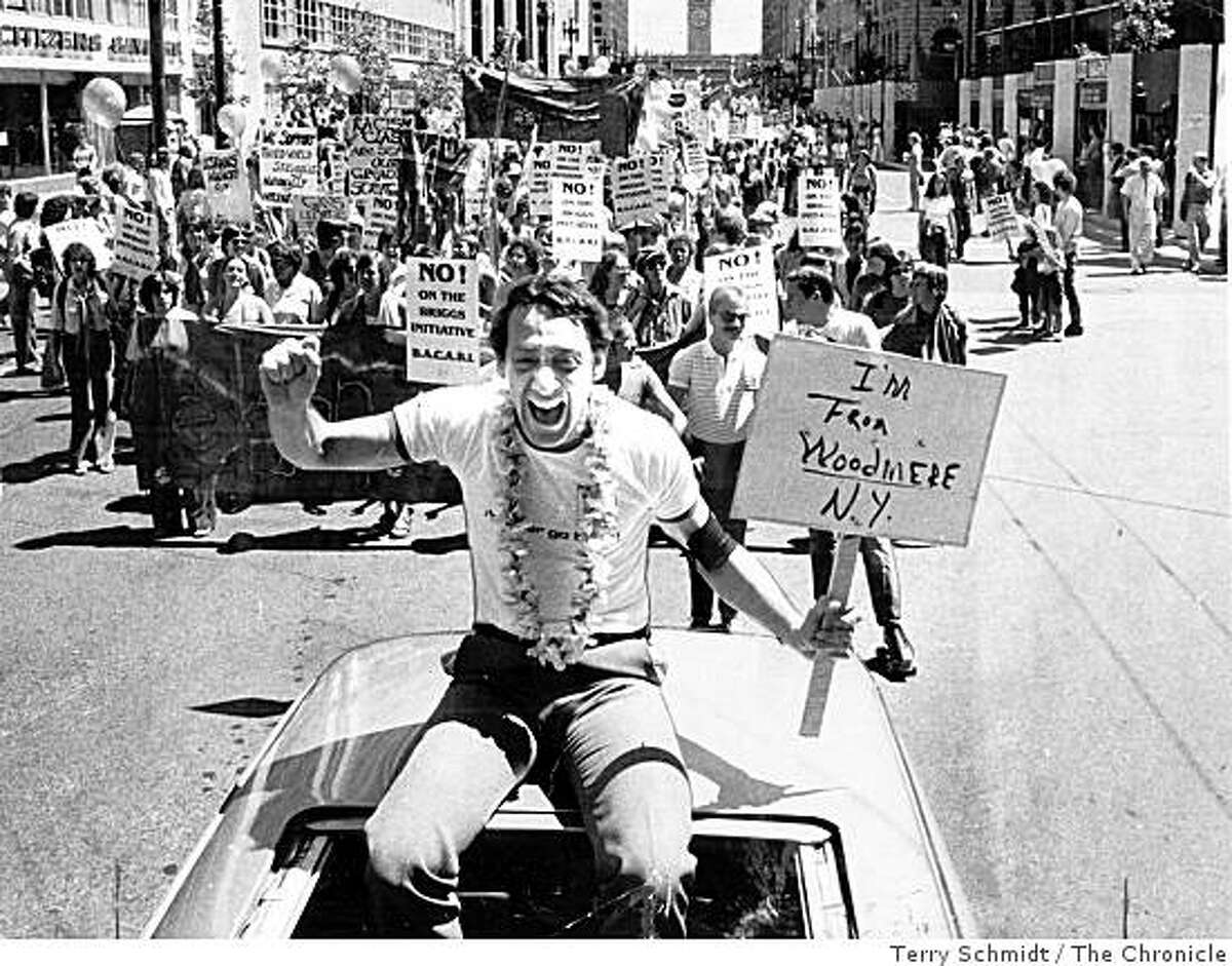 Harvey Milk, one of the first openly gay public officials in the United States, rides up Market Street in San Francisco in a 1978 Gay Freedom Parade.