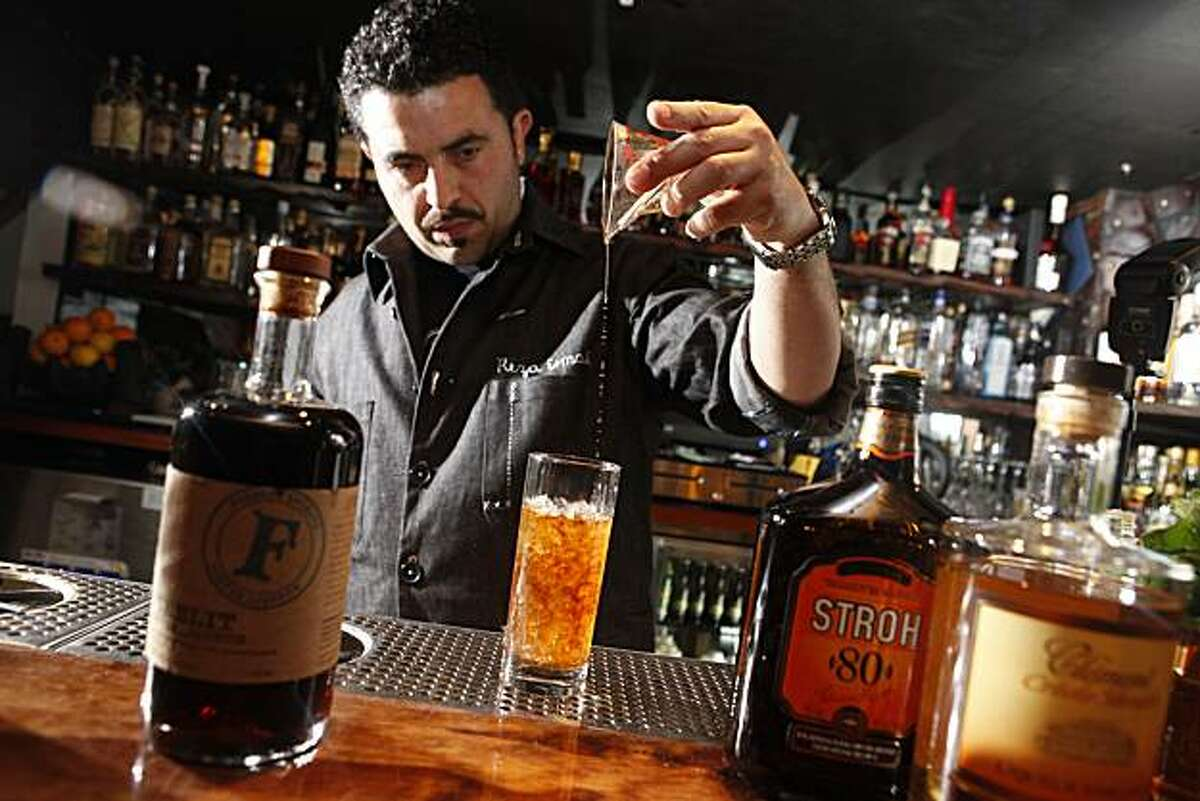 Reza Esmaili, bar tender at Smuggler's Cover, makes a Rear Admiral's Swizzle, which showcases a coffee liquor called Firelit, on Thursday May 20, 2010 in San Francisco, Calif.