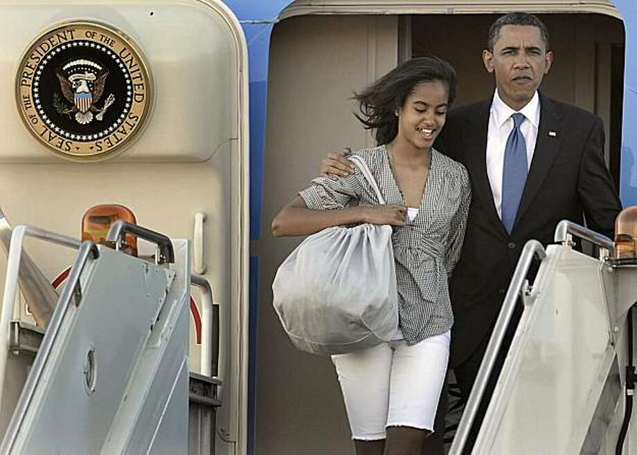 President Barack Obama and daughter Malia walk off Air Force One after arriving at Chicago's O'Hare International Airport in Chicago, Thursday, May 27, 2010. Photo: Paul Beaty, AP