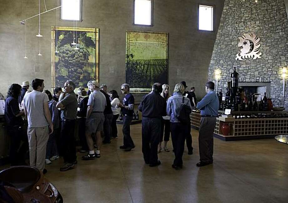 PASO ROBLES, CA--- A large crowd enjoys the beautiful tasting room at Vina Robles winery in Paso Robles. Hans Nef purchased the oak studded land that became the Vina Robles estate in 1996. Vina Robles wines are modern, emphasizing fruit intensity, balance and accessibility. Their selection features Chardonay, Sauvignon Blanc, SyrŽe, Petite Sirah, Suendero, Cabernet Sauvignon, and Zinfandel among others. Photo: Courtesy, Tomas Ovalle