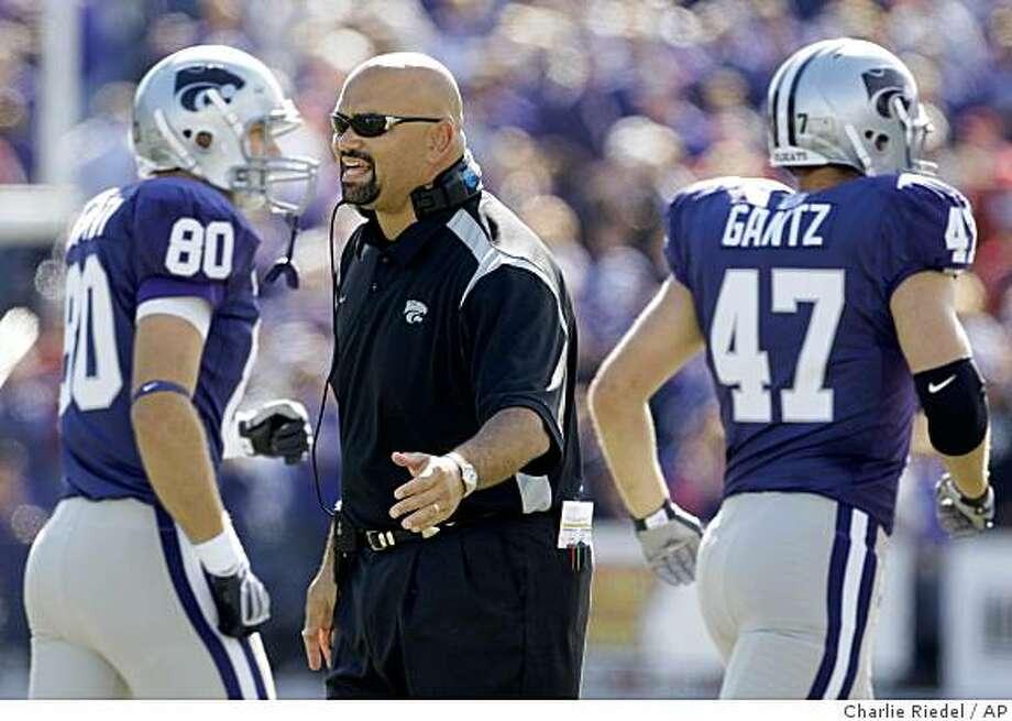 Kansas State coach Ron Prince talks to his players Brett Alstatt (80) and Gabe Gantz (47) during the second quarter against Oklahoma, Saturday, Oct. 25, 2008 in Manhattan, Kan. Photo: Charlie Riedel, AP