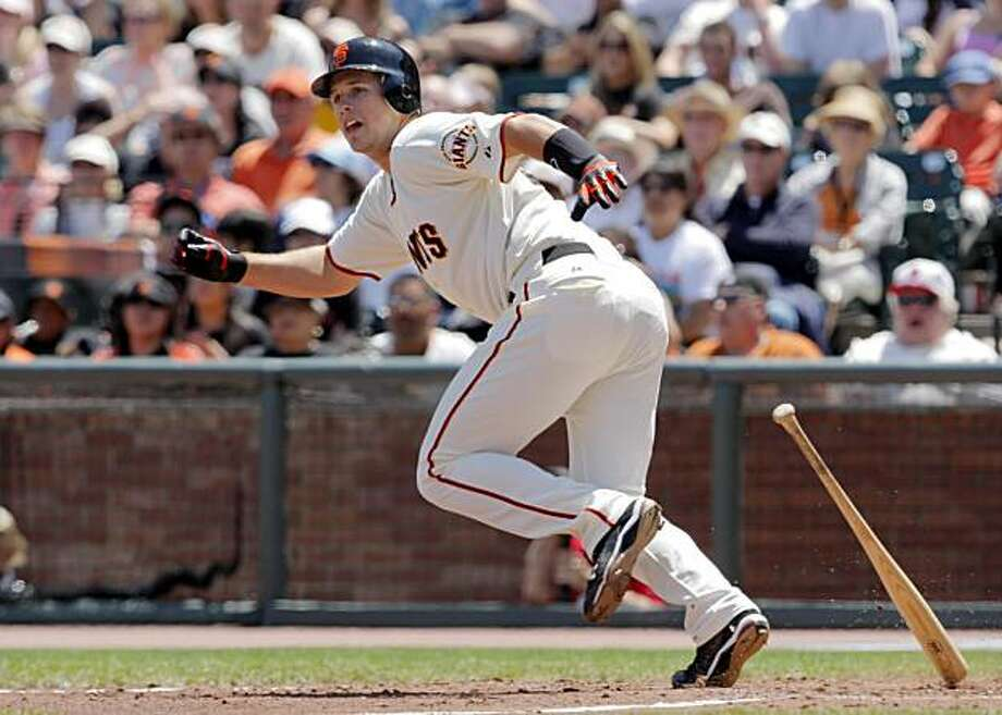 Buster Posey drops his bat as he watches the ball go into left field on his second double of the day in the bottom of the fourth inning in San Francisco on Sunday. Photo: Carlos Avila Gonzalez, The Chronicle