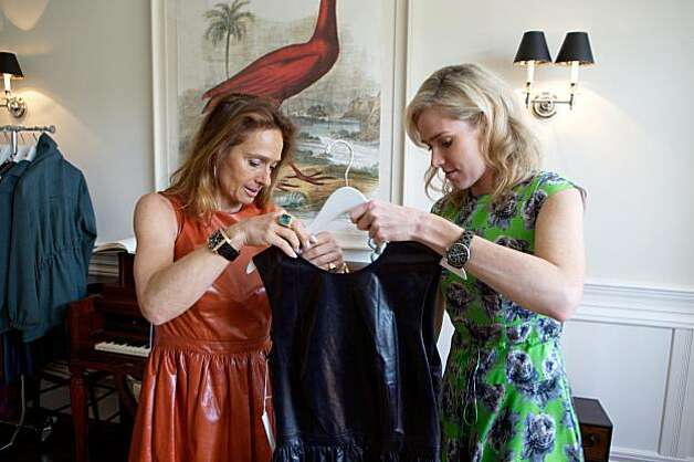 Elisabeth Thieriot (left) and Heidi Castelein look at clothing by designer Lyn Devon at  Fall 2010 fashion trunk show for the designer, held April 19, 2010, at the home of Hilary McInereny, in San Francisco, Calif. Photo: Thor Swift, Special To The Chronicle