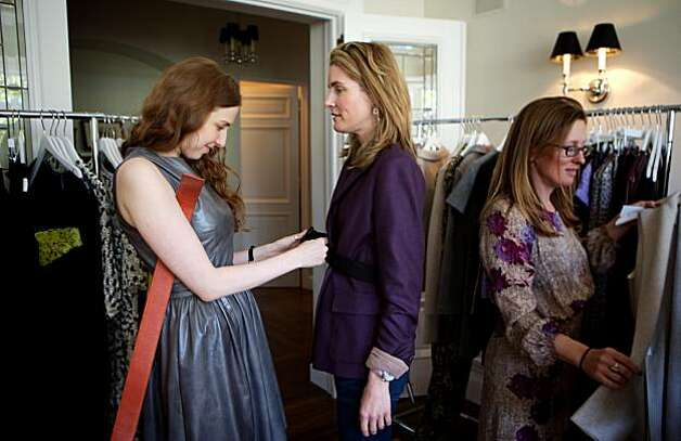 Designer Lyn Devon (left) helps Hilary McInereny try on one of her designs at the Fall 2010 fashion trunk show for the designer, held April 19, 2010, at the home of Hilary McInereny, in San Francisco, Calif. Photo: Thor Swift, Special To The Chronicle