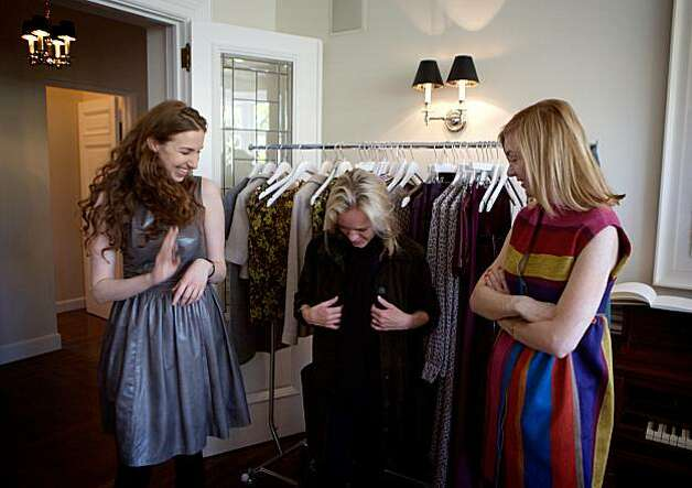 Designer Lyn Devon (left) shows various outfits to (get name) and Katie Schwab at the Fall 2010 fashion trunk show for the designer, held April 19, 2010, at the home of Hilary McInereny, in San Francisco, Calif. Photo: Thor Swift, Special To The Chronicle