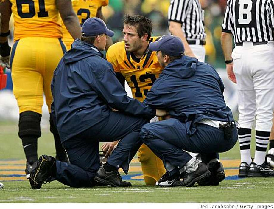 BERKELEY, CA - NOVEMBER 01:  Starting quarterback Kevin Riley #13 of the California Golden Bears is attended to by trainers after getting hit against the Oregon Ducks during an NCAA football game on November 1, 2008 at Memorial Stadium in Berkeley, California.  (Photo by Jed Jacobsohn/Getty Images) Photo: Jed Jacobsohn, Getty Images
