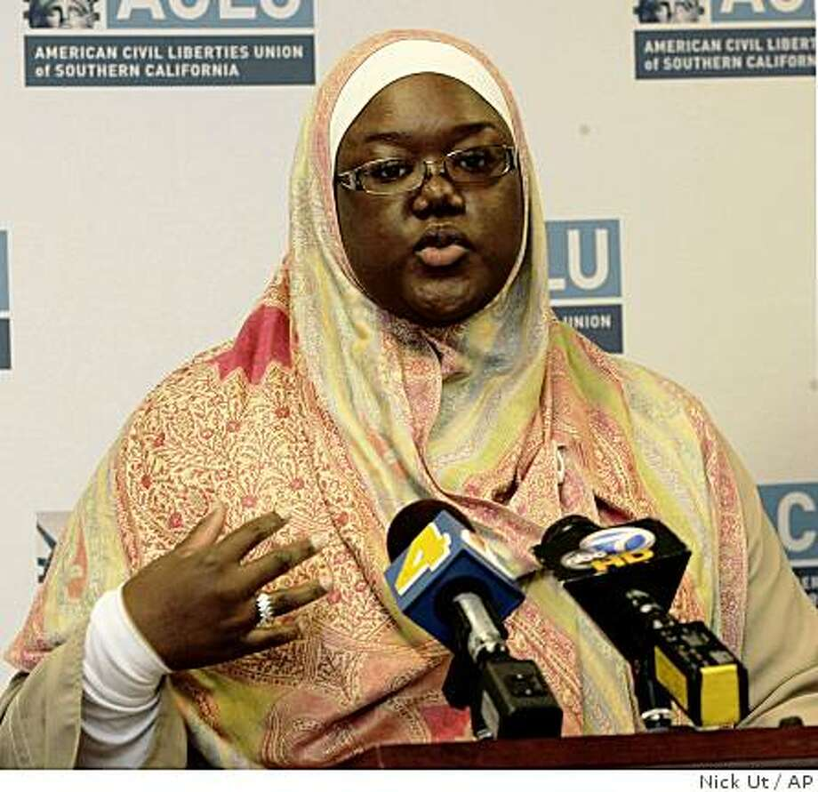 Jameelah Medina speaks during a news conference Monday, Nov. 3, 2008, in Orange, Calif. where she said her religious freedom was violated by deputies who made her remove her head covering after being arrested in December 2005 for having an invalid train pass. San Bernardino County will allow jailed Muslim women to wear headscarves after settling a lawsuit Monday with Medina and award her with $45,000 in damages. Medina spent a day in jail, but was never prosecuted in the case. (AP Photo/Nick Ut) Photo: Nick Ut, AP