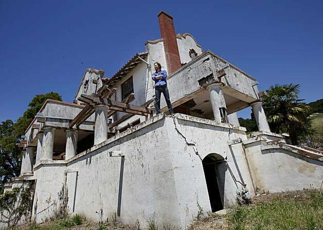 Vintner Andrew Mariani stands on a wall of his hacienda he plans to restore. The Scribe Winery in the Carneros area of Sonoma sits on a historic winery parcel off Napa Road.  Vintner Andrew Mariani works with brother Adam Mariani and viticulturalist Andrew Avelar among others on their new label unveiling. Photo: Brant Ward, The Chronicle