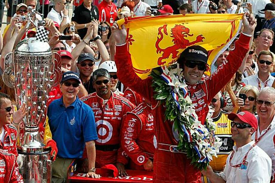 INDIANAPOLIS - MAY 30:  Dario Franchitti of Scotland, driver of the #10 Target Chip Ganassi Racing Dallara Honda, celebrates in victory lane after winning the IZOD IndyCar Series 94th running of the Indianapolis 500 at the Indianapolis Motor Speedway on May 30, 2010 in Indianapolis, Indiana. Photo: Jonathan Ferrey, Getty Images