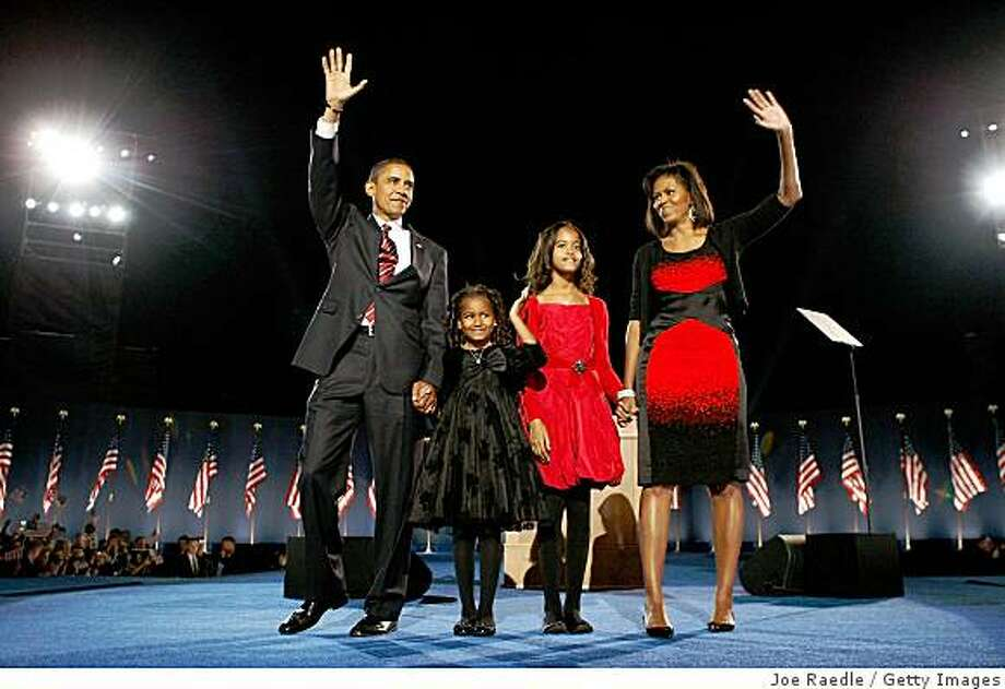 CHICAGO - NOVEMBER 04:  U.S. President elect Barack Obama stands on stage along with his wife Michelle and daughters Malia (red dress) and Sasha  (black dress) during an election night gathering in Grant Park on November 4, 2008 in Chicago, Illinois. Obama defeated Republican nominee Sen. John McCain (R-AZ) by a wide margin in the election to become the first African-American U.S. President elect.  (Photo by Joe Raedle/Getty Images) Photo: Joe Raedle, Getty Images