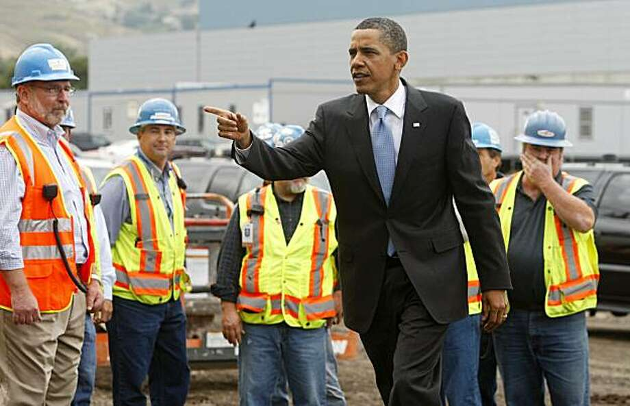 FREMONT, CA - MAY 26:  U.S. President Barack Obama heads inside to deliver a speech after meeting with construction workers building a new Solyndra solar panel factory May 26, 2010 in Fremont, California. President Obama toured Solyndra Inc., a growing solar power equipment facility that is adding jobs as they expand their operation. Photo: Pool, Getty Images